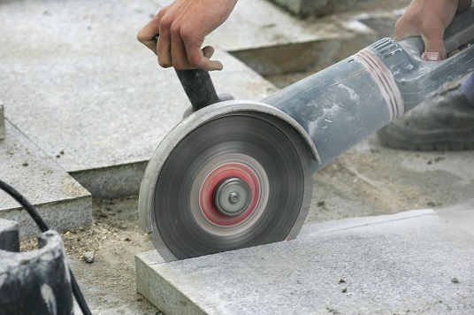 circular saw cutting marble flooring